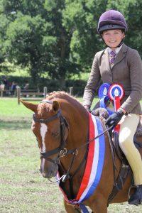 Birkinbrook Arabella TopSpec BSPS Supreme Working Hunter Pony Champion ridden by Matilda Lanni and owned by Milla Lanni