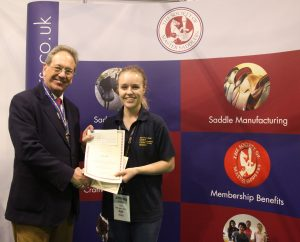 Megan Webb receives her award from Hugh Thomas