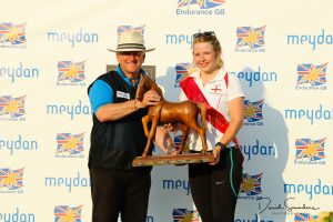 Ella Bunting (2018 British National Young Rider Champion) receiving her prizes from Ground Jury President Ian Williams (GBR)